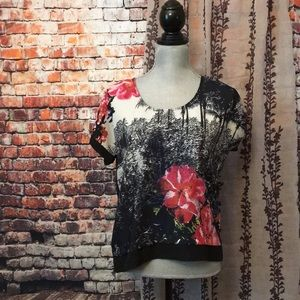 Gorgeous floral blouse with sheer back